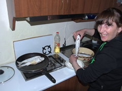 Sofi frying up some fish for dinner