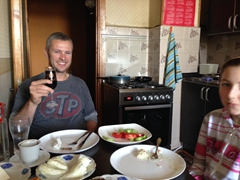 Robby enjoying a glass of wine for breakfast while Ani looks on in amusement