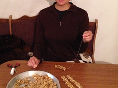 Becky making churchkhela (Georigan snickers)