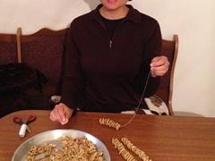 Becky making churchkhela (Georigan snickers)