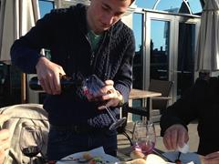 Zura pouring us wine at the World Palace Hotel; Batumi