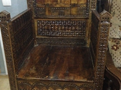 Carved wooden chair. Check out the fortress towers!