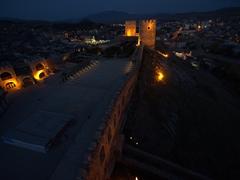 Rabati Castle lit up at night