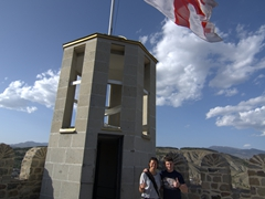 Becky and Giorgi under the Georgian flag; Rabati Castle