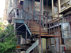 Precarious staircase leading up to an old house; Tbilisi