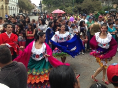 Dancers perform during the Carnival Parade in Cuenca