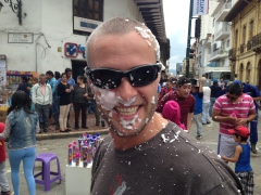 Robby becomes a victim of celebratory foam spraying locals during the Cuenca Carneval Parade