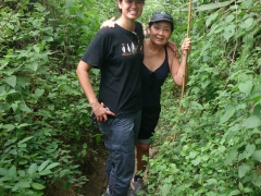 Becky and Ann walking along a narrow, deep-trenched horse trail surrounded by plush greenery; Vilcabamba