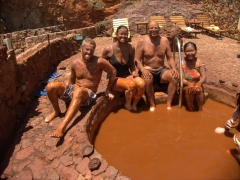 Because it is supposed to be good for the skin, Robby, Becky, Bob and Ann slather on a coat of local red mud at Piedra de Agua Fuente Termal & Spa; Cuenca