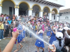 Cuencanos love to celebrate Carneval by spraying parade performers and spectators with cans of foam spray; Cuenca