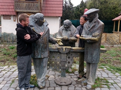 Posing with statues in Dilijan