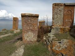 Ancient khachkars overlooking Lake Sevan; Hayravank Monastery