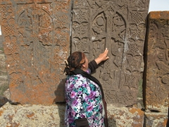 Armenian lady describing the carving on her favorite khachkar; Noratus