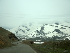 The snowy scenery near the top of the mountain pass