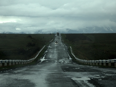 Roads were in poor condition in Armenia. Cars drive erratically to avoid the numerous potholes